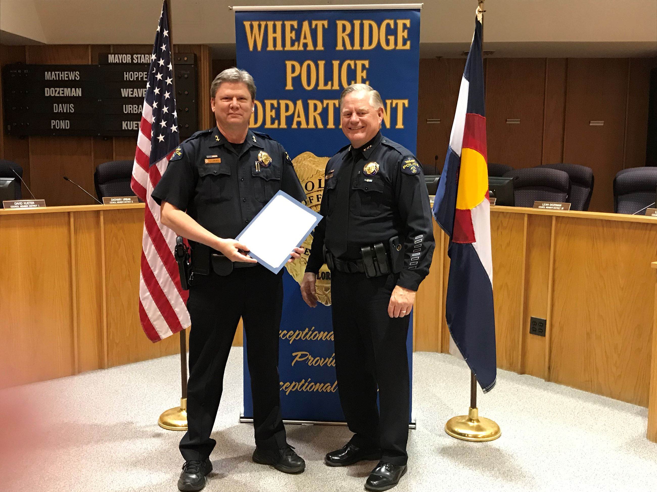 Chief presents award to Division Chief Lorentz